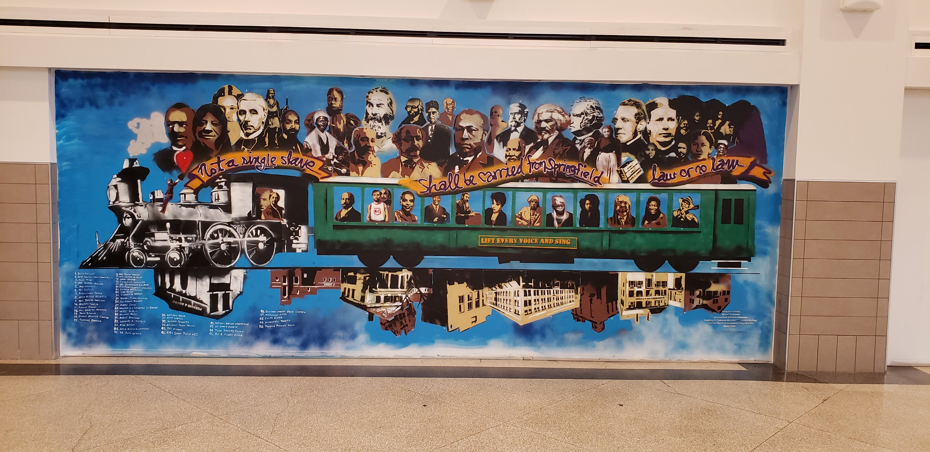 Mural of black historic figures from Springfield and greater New England. The figures are arranged as passengers on a train. The background is blue.